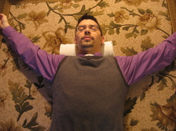 When lying on the rolled towel for neck and headache relief, spread your arms, palms up.